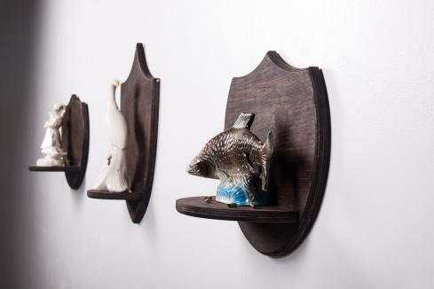 .22 Pickup, Installation View. 2013. Wood, Found Figurines, .22 Shell Casings, Glue.