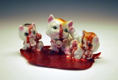 """Dead Kittens. 2012. Porcelain, Resin, Glitter. 5"""" x 2.75"""". DeBoer Collecion."""