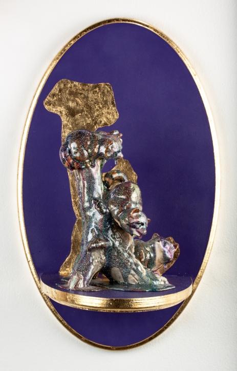 "Altarpiece I (Raccoons). 2012. Wood, Paint, Gold Leaf, Found Figurine, Resin, Glitter. 18"" x 11"""